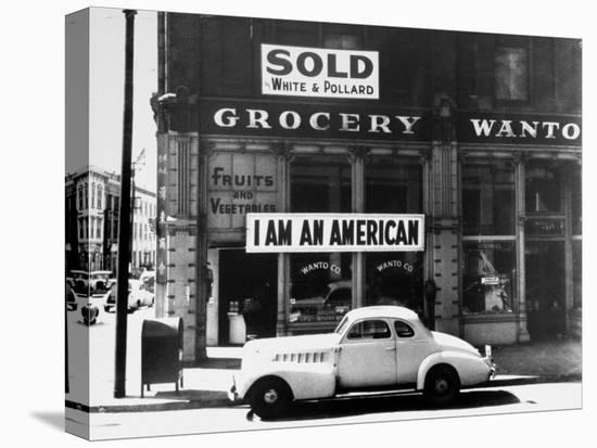 """Store Sign Reads, """"I am an American,"""" After Pearl Harbor Attack, and """"Sold"""", Following Evacuation-Dorothea Lange-Stretched Canvas Print"""