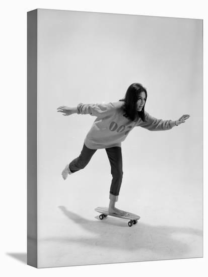 Studio Photos of Gloria Steinem Riding a Skateboard with a 007 James Bond Sweatshirt, 1965-Yale Joel-Stretched Canvas Print