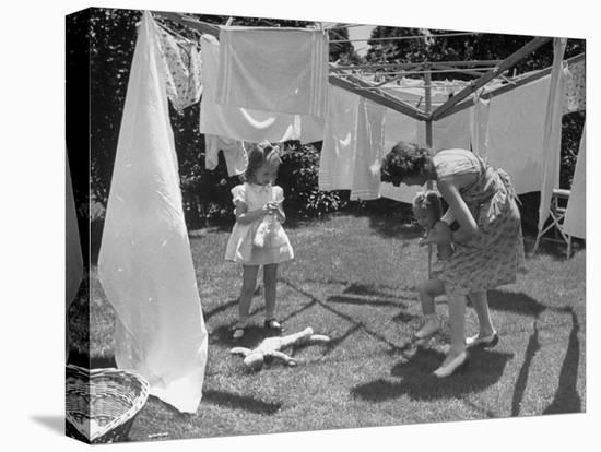 Suburban Mother Playing with Her Two Daughters While Hanging Laundry in Backyard-Alfred Eisenstaedt-Stretched Canvas Print