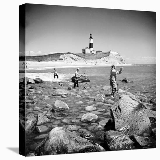 Surf Casting Fishermen Working the Shore Near the Historic Montauk Point Lighthouse-Alfred Eisenstaedt-Stretched Canvas Print