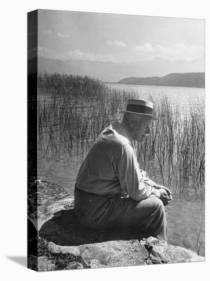 Swiss Psychiatrist Dr. Carl Jung Sitting on Stone Wall Overlooking Lake Zurich-Dmitri Kessel-Stretched Canvas Print