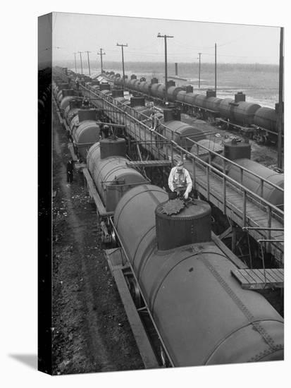 Tank Cars Line Up to Take on Crude Oil at Siding of Standard Oil of New Jersey Refinery--Stretched Canvas Print