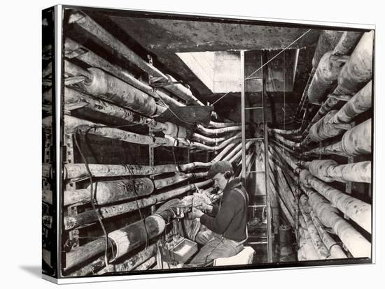 Telephone Repair Man Splicing a Wire in a Manhole for Telephone Cables of the New York Telephone Co-Margaret Bourke-White-Stretched Canvas Print
