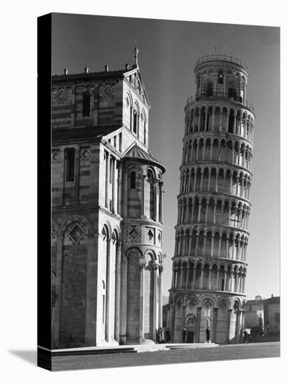 The Famed Leaning Tower of Pisa Standing Beside the Baptistry of the Cathedral-Margaret Bourke-White-Stretched Canvas Print