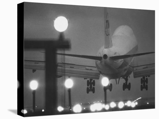 Twa Plane Landing at O'Hare Airport--Stretched Canvas Print