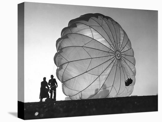 Two Irving Air Chute Co. Employees Struggling to Pull Down One of their Parachutes after Test Jump-Margaret Bourke-White-Stretched Canvas Print