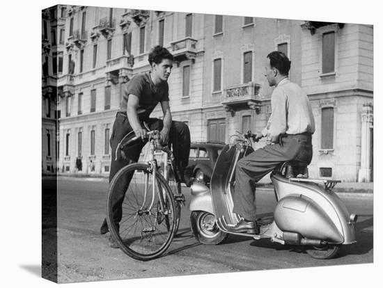 Two Men Talking in Street with Vespa Scooter and Bicycle-Dmitri Kessel-Stretched Canvas Print