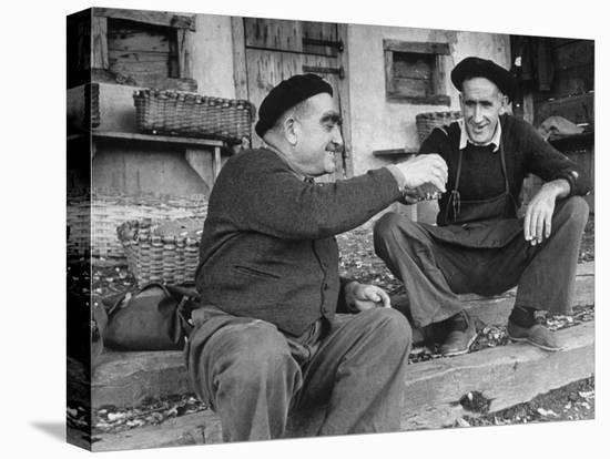 Two Older Basque Men Sitting on a Porch Toasting, as They Prepare to Drink Together-Dmitri Kessel-Stretched Canvas Print