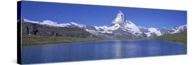 Panoramic View of a Snow Covered Mountain by a Lake, Matterhorn, Zermatt, Switzerland--Stretched Canvas Print