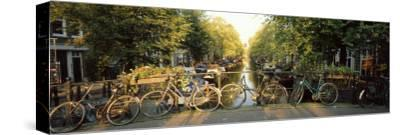 Bicycles on Bridge Over Canal, Amsterdam, Netherlands--Stretched Canvas Print