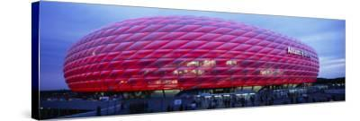 Soccer Stadium Lit Up at Dusk, Allianz Arena, Munich, Germany--Stretched Canvas Print