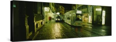 Cable Cars Moving on a Street, Freiburg, Germany--Stretched Canvas Print