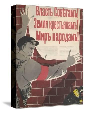 Big Brave Communist Worker Fixes a Poster on a Wall--Stretched Canvas Print