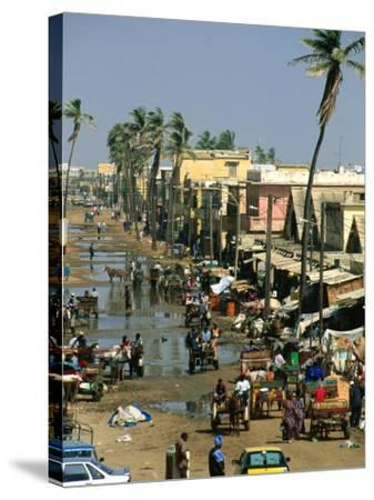 People Going About Their Business in Street, St. Louis, Senegal-Frances Linzee Gordon-Stretched Canvas Print