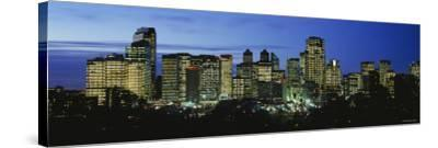 Buildings Lit Up at Dusk, Calgary, Alberta, Canada--Stretched Canvas Print