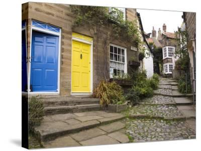 Yellow and Blue Doors on Houses in the Opening, Robin Hood's Bay, England-Pearl Bucknall-Stretched Canvas Print