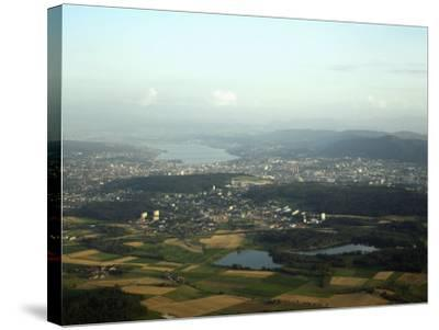 Aerial View of the City, Lakes and Surrounding Hills, Zurich, Switzerland-Jean-luc Brouard-Stretched Canvas Print
