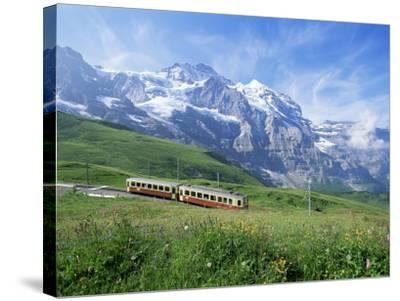 Jungfrau Railway and the Jungfrau, 13642 Ft., Bernese Oberland, Swiss Alps, Switzerland-Hans Peter Merten-Stretched Canvas Print