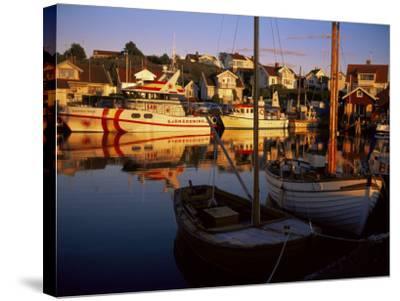 Sundown Over South Harbour, Village of Fjallbacka, Bohuslan, Sweden, Scandinavia-Kim Hart-Stretched Canvas Print