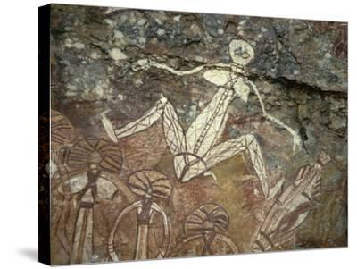 Barrginj, Wife of Namarrgon the Lightning Man, a Supernatural Ancestor at Aboriginal Rock Art Site-Robert Francis-Stretched Canvas Print
