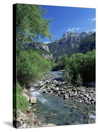 Torla, the River Ara and Mondarruego, Huesca, Pyrenees, Aragon, Spain-Ruth Tomlinson-Stretched Canvas Print