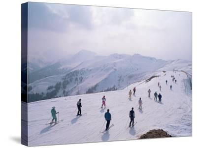 Skiers, Steinberkogel Area, Kitzbuhel, Austria-Adam Woolfitt-Stretched Canvas Print