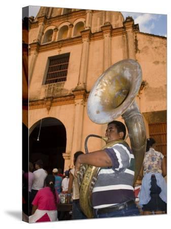 Tuba Player in Front of Iglesia San Juan Bautista de Subtiava During Semana Santa, Leon, Nicaragua-Margie Politzer-Stretched Canvas Print