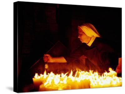 Nun Attending Candles at Stone Gate Shrine, Zagreb, City of Zagreb, Croatia-Richard I'Anson-Stretched Canvas Print