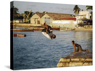 Children Diving in Sea at Waterfront, Stone Town, Zanzibar Town, Zanzibar West, Tanzania-Ariadne Van Zandbergen-Stretched Canvas Print