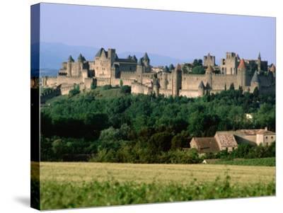 La Cite, 12th Century Castle in Distance, Carcassonne, Languedoc-Roussillon, France-John Elk III-Stretched Canvas Print