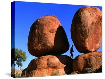 Man Standing in Between Boulders, Devil's Marbles Conservation Reserve, Australia-John Banagan-Stretched Canvas Print