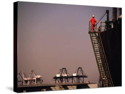 Crew Member Entering Cargo Ship on Ladder, Los Angeles, California-Thomas Winz-Stretched Canvas Print