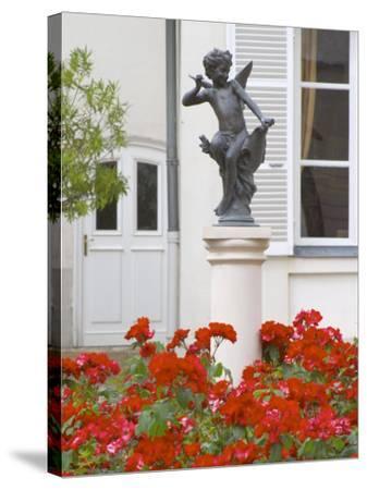 Courtyard Statue of Cupid, Amour De Deutz at Champagne Deutz, Ay, Vallee De La Marne, France-Per Karlsson-Stretched Canvas Print