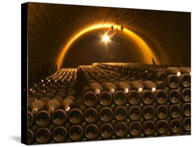 Champagne Bottles in Vaulted Cellar, Champagne Deutz, Ay, Vallee De La Marne, Ardennes, France-Per Karlsson-Stretched Canvas Print