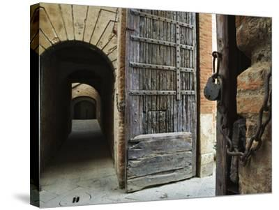 Wooden Fortified Gates and Alley of Medieval Town, Buonconvento, Italy-Dennis Flaherty-Stretched Canvas Print