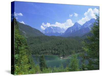View to the Zugspitze Across the Fernsteinsee, Tirol (Tyrol), Austria, Europe-Ruth Tomlinson-Stretched Canvas Print