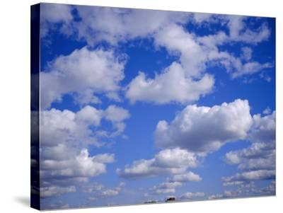 Blue Sky and Puffy White Clouds-Fraser Hall-Stretched Canvas Print