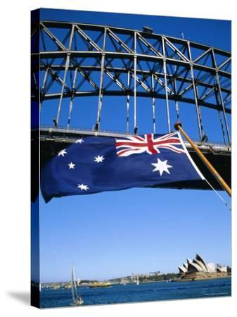 Flag, Sydney Harbour Bridge and Opera House, Sydney, New South Wales, Australia-Fraser Hall-Stretched Canvas Print