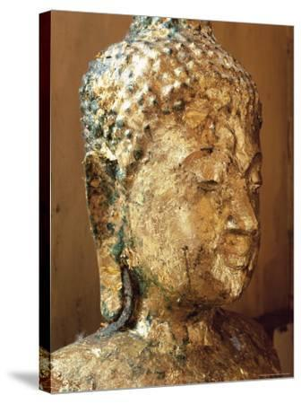 Close-Up of the Head of a Statue of the Buddha Covered in Gold Leaf, Thailand-Gavin Hellier-Stretched Canvas Print