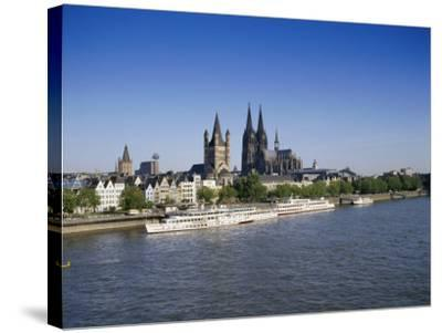 The Cathedral and River Rhine, Cologne, North Rhine Westphalia, Germany-Hans Peter Merten-Stretched Canvas Print