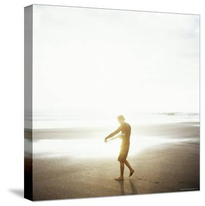 Young Man Waxes His Board Before Entering Marabella's Waves, Costa Rica, Central America-Aaron McCoy-Stretched Canvas Print
