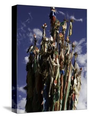 Cluster of Tibetan Prayer Flags against a Blue Sky with Clouds, Qinghai, China-David Evans-Stretched Canvas Print