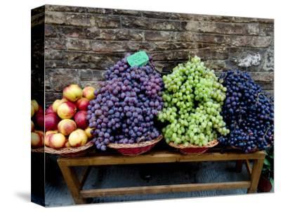 Grapes and Nectarines on a Bench at a Siena Market, Tuscany, Italy-Todd Gipstein-Stretched Canvas Print