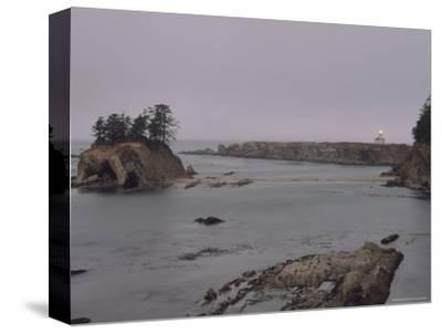 Distant View of the Cape Arago Lighthouse, Oregon-Phil Schermeister-Stretched Canvas Print