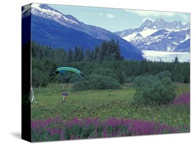 Paraglider Landing in a Field near the Mendenhall Glacier, Alaska-Rich Reid-Stretched Canvas Print