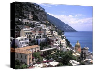 The Beach and City of Positino on the Amalfi Coast in Italy-Richard Nowitz-Stretched Canvas Print