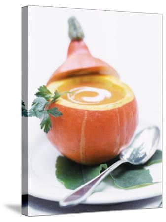 Pumpkin Soup with Creme Fraiche in Hollowed-Out Pumpkin-Brigitte Sporrer-Stretched Canvas Print