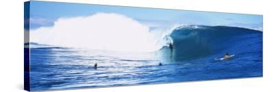 Three People Bodyboarding in the Ocean, Tahiti, French Polynesia--Stretched Canvas Print