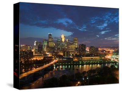 Evening Skyline Scene from St. Anthony Main, Minneapolis, Minnesota-Walter Bibikow-Stretched Canvas Print