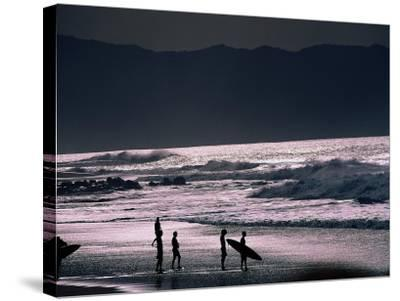 Surfers at Sunset, Ehukai, Oahu, Hawaii-Bill Romerhaus-Stretched Canvas Print